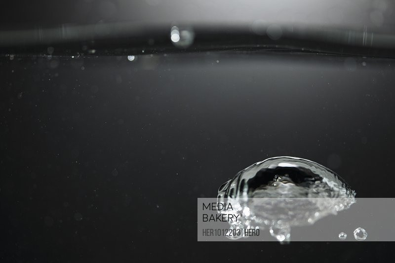 Water droplet rising to the surface