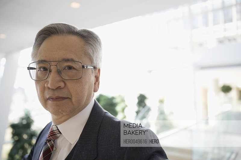 Portrait confident senior businessman