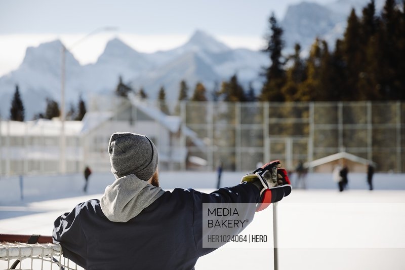 Man playing outdoor ice hockey