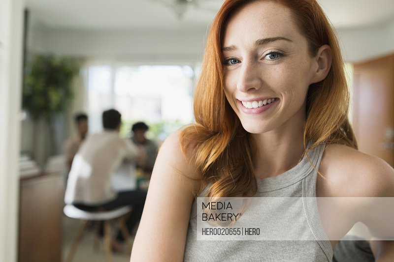 Portrait smiling woman with red hair