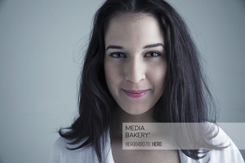 Portrait confident brunette Caucasian young woman