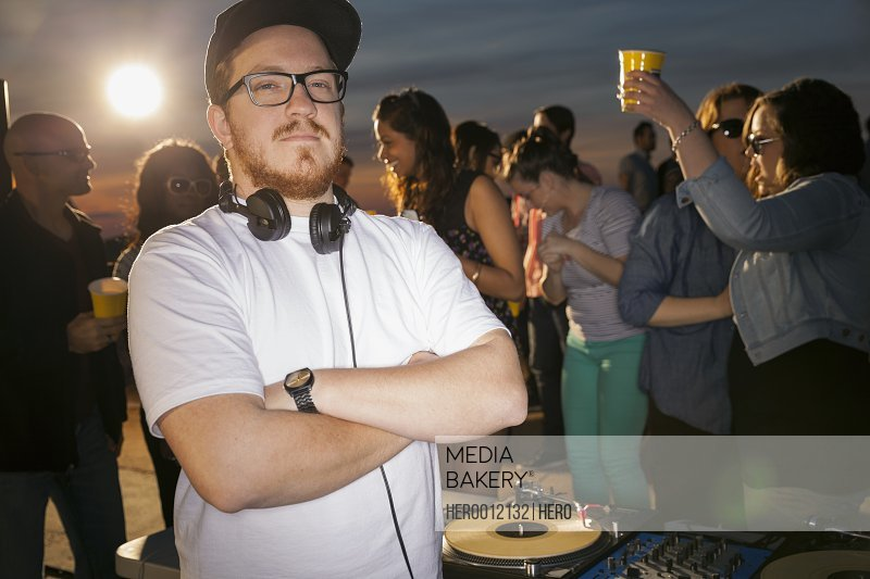 Portrait of confident DJ at rooftop party