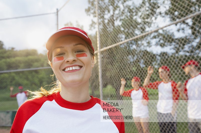 Baseball player smiling on field