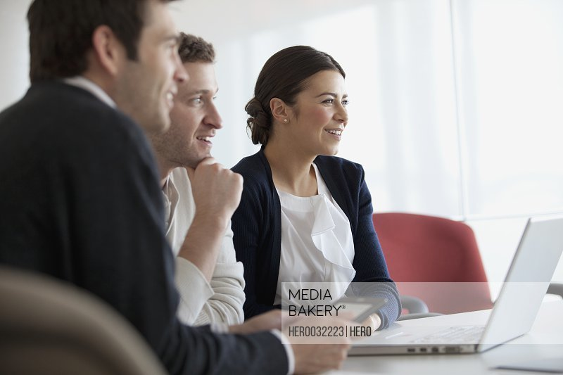 coworkers discussing around conference table