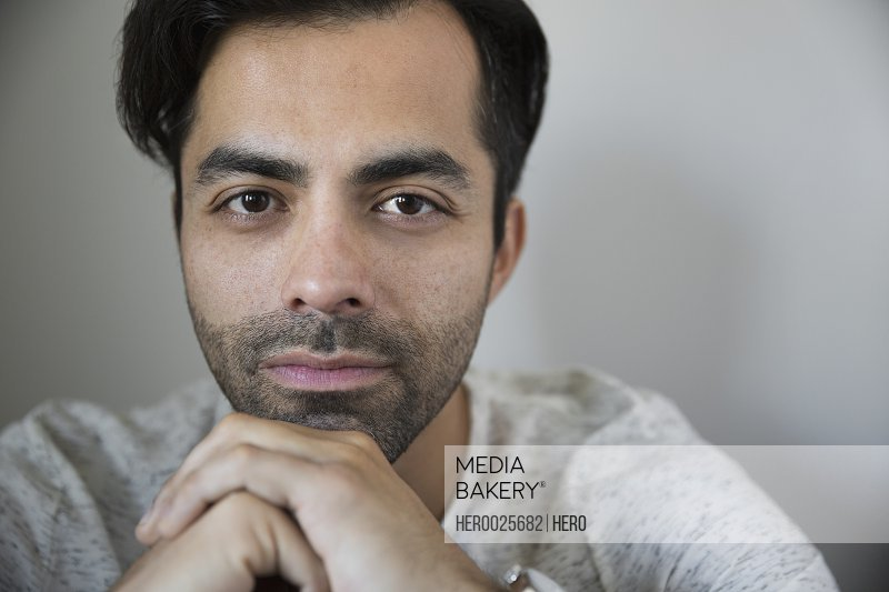 Portrait serious man with black hair and stubble
