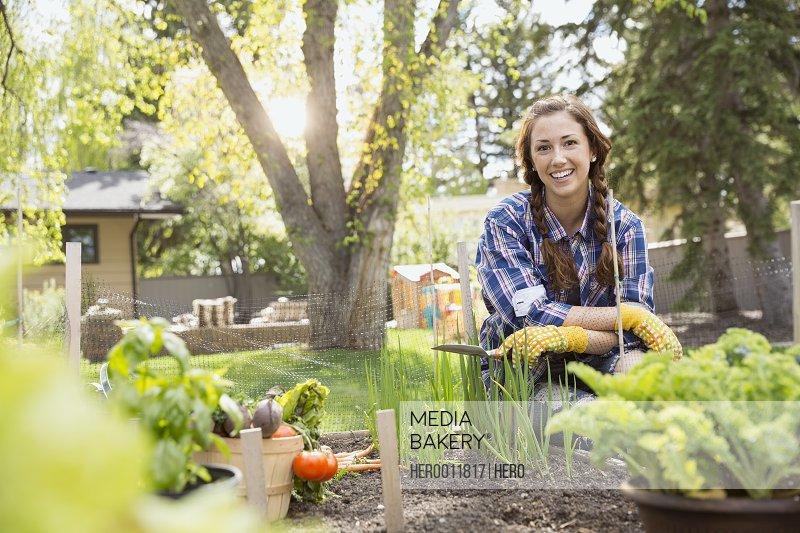 Portrait of smiling woman in vegetable garden