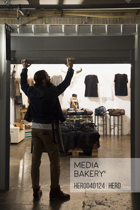 Leather shop owner entrepreneur opening shop gate