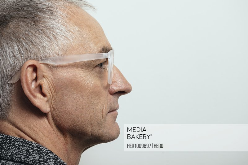 Profile thoughtful mature man in eyeglasses