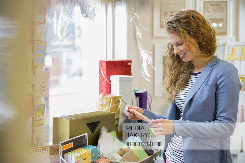 Young woman shopping at card store