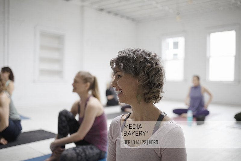 Smiling woman in yoga class