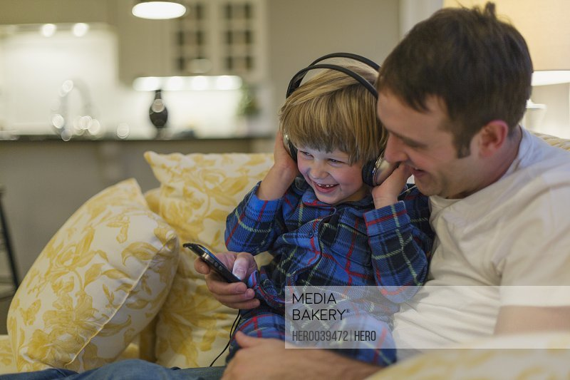 Young boy with headphones listening to music