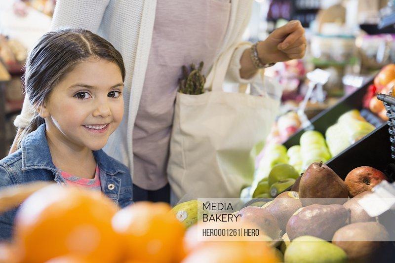 Portrait of girl shopping for produce in market