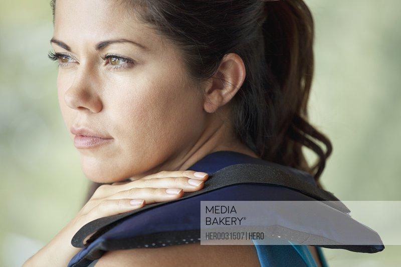 woman applying heat to sore muscle