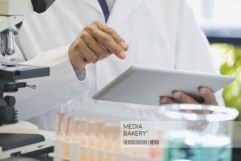 Scientist using digital tablet in laboratory