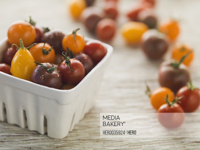 Variety of fresh Tomatoes in pint container