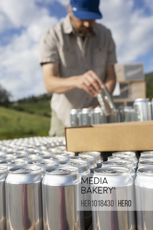 Man canning outside distillery