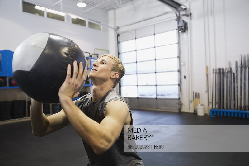 Man exercising with medicine ball