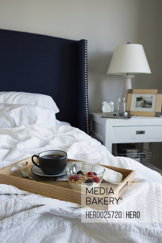 Breakfast on tray on bed in bedroom