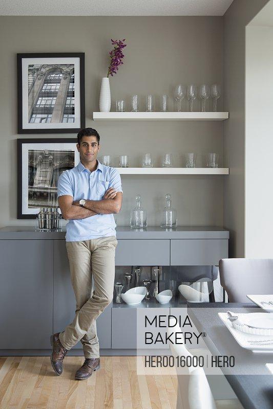 Portrait of confident man in kitchen