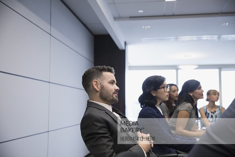 Businessman listening in conference room meeting