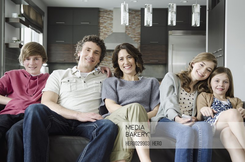 portrait of family on couch