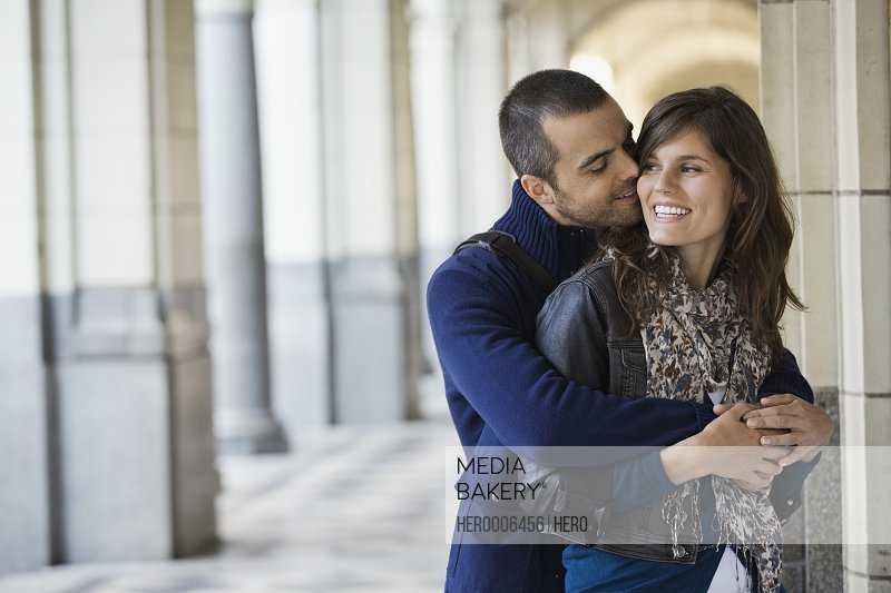 Affectionate couple standing outdoors