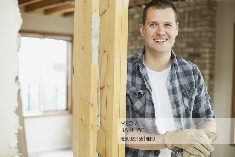 happy mid adult man in house renovation
