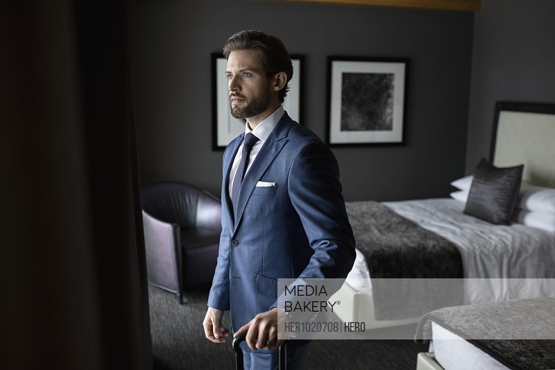Thoughtful businessman in hotel room