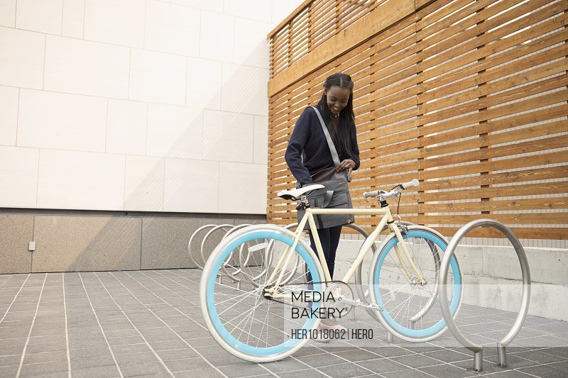 Businesswoman commuter with bicycle