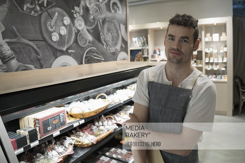 Portrait confident male worker in grocery store