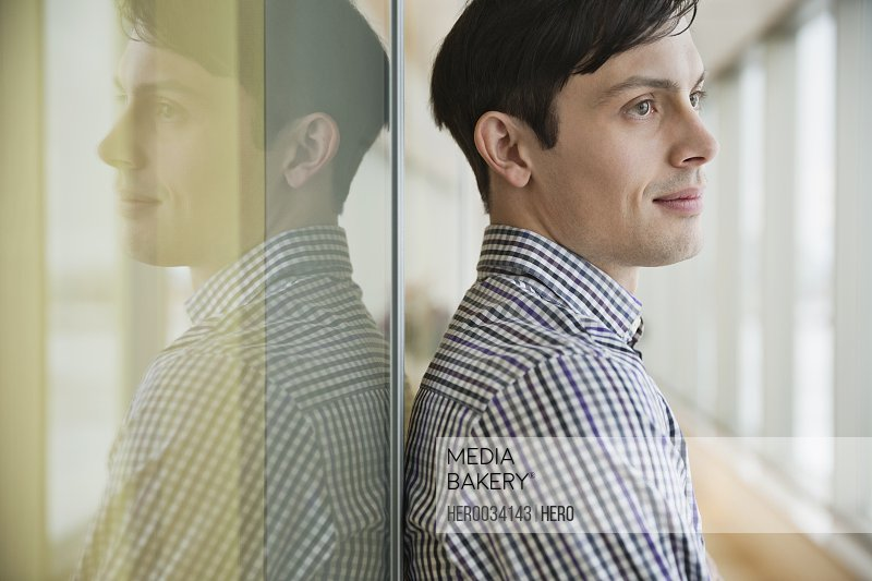 Side view of businessman looking away in office