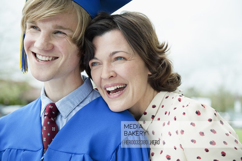 young adult male graduate with his mother