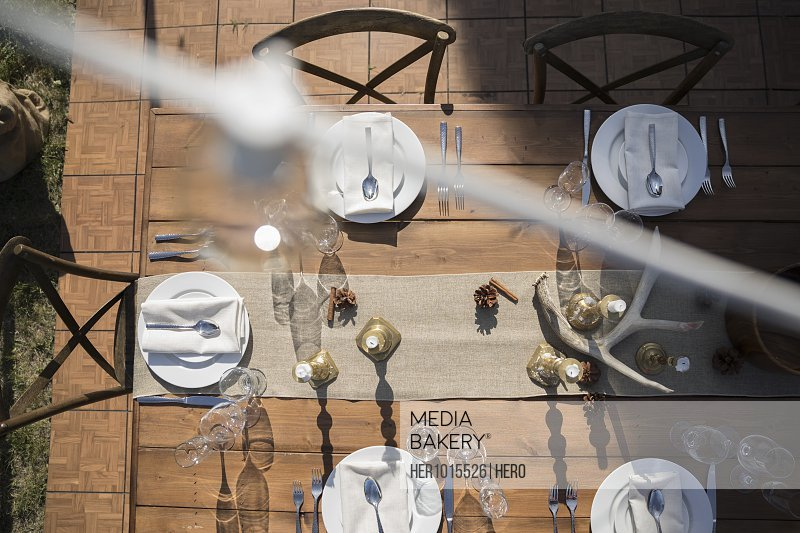 Overhead view placesettings on sunny patio table