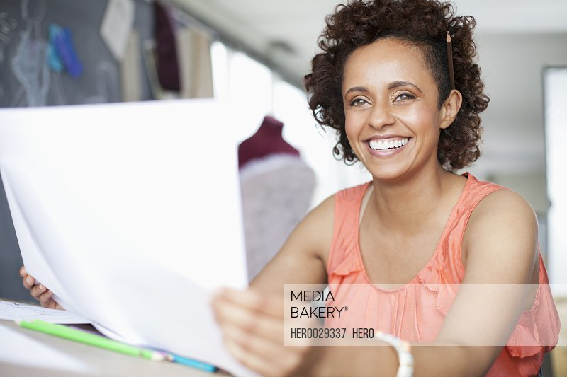 pretty african american clothing designer with sketch