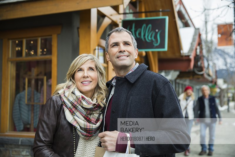 Couple standing outside storefront