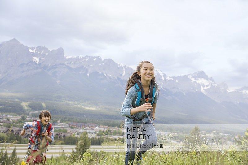 Children hiking on rural hillside