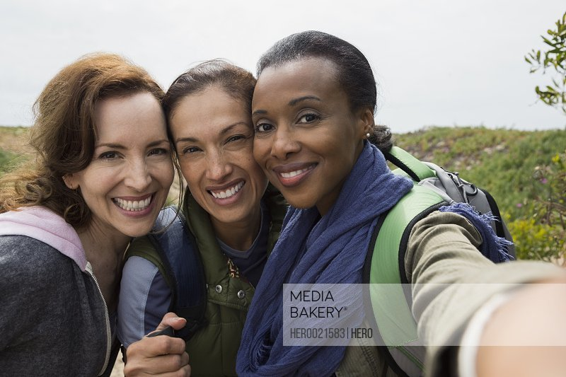 Portrait smiling women hikers