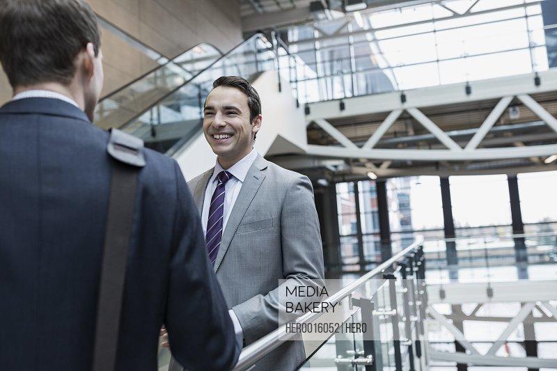 Businessmen talking in atrium