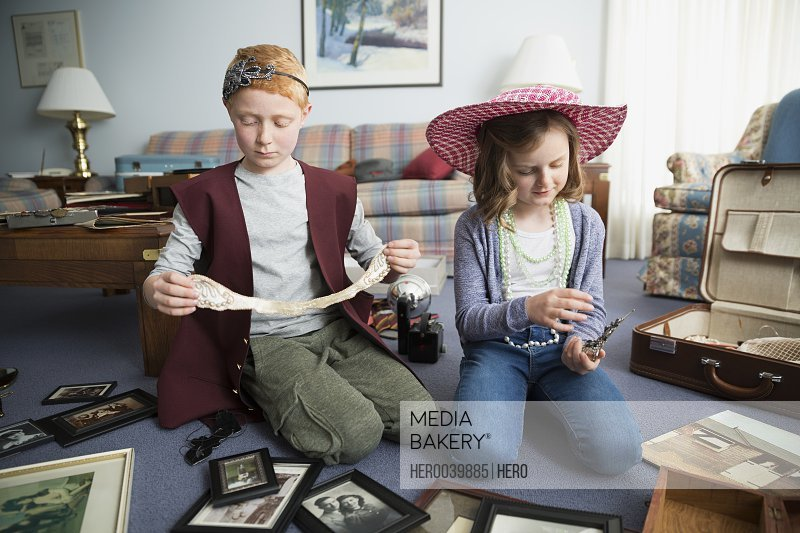 Brother and sister going through old memorabilia