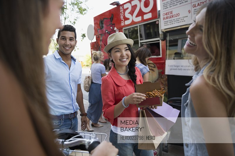 Smiling friends outside food truck