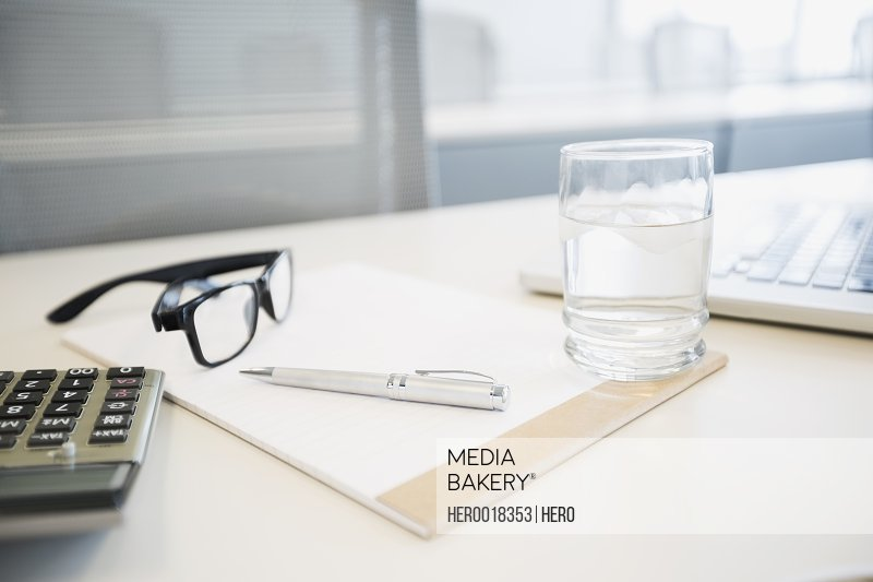 Water glass notepad pen eyeglasses and notepad