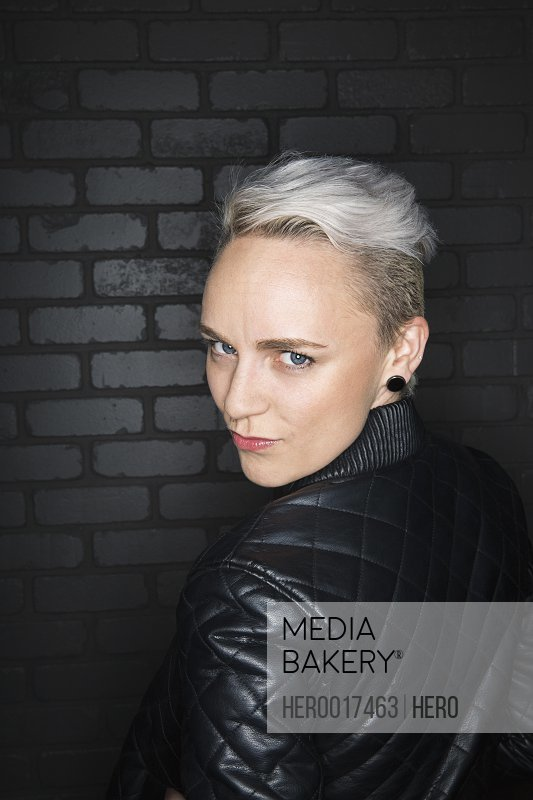 Portrait of serious blonde woman wearing leather jacket