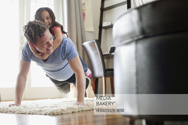 father and young daughter excersizing together
