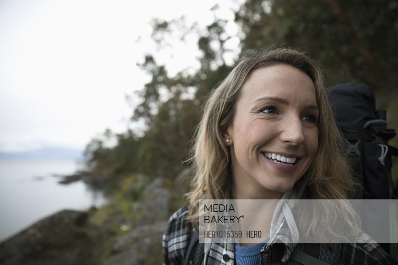 Portrait smiling, carefree female backpacker