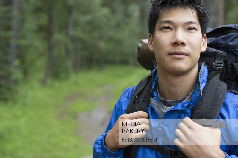 portrait of Asian make backpacker in the woods