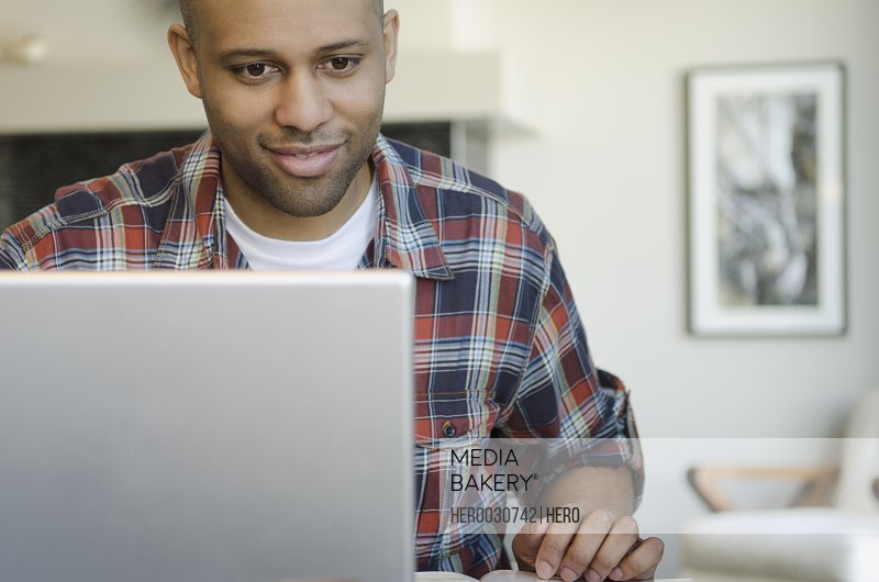 attractive man working on laptop