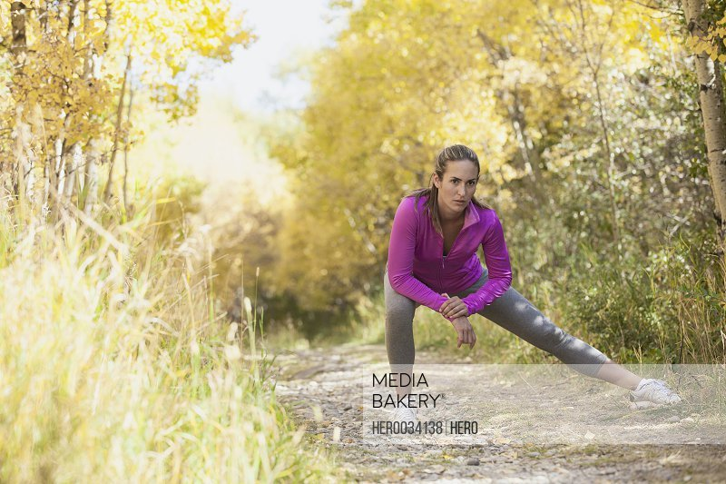 Woman stretching before outdoor run.