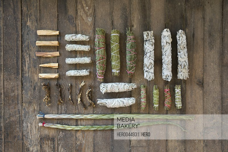 Overhead view smudge sticks and patio santo on wooden floor