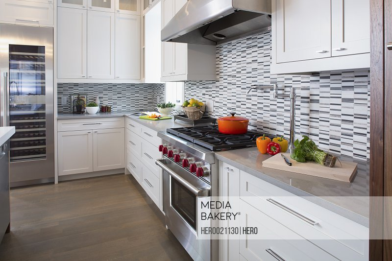 Modern white kitchen with stainless steel range