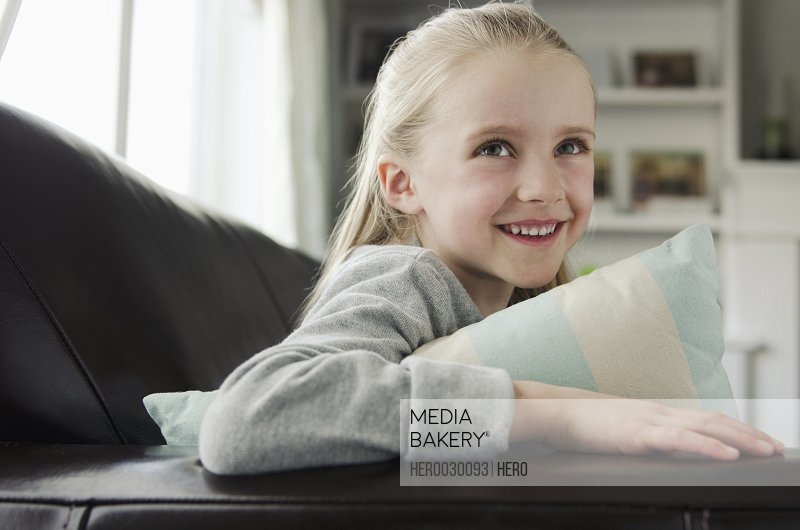 portrait of cute young blonde girl on couch